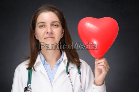 doctor holding a heart shaped balloon