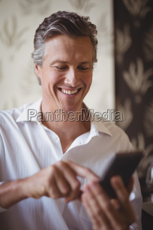 mature man using mobile phone