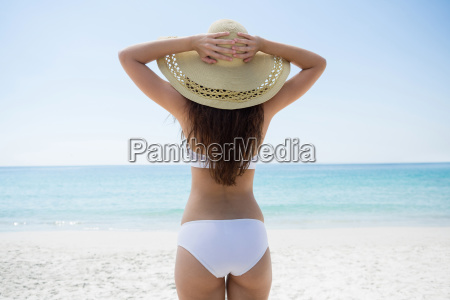 woman wearing sun hat while standing