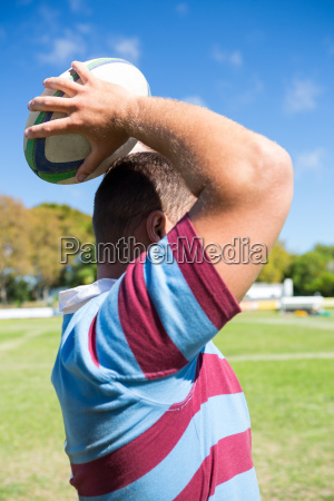 side view of rugby player throwing