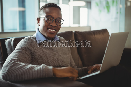 male executive using laptop in office