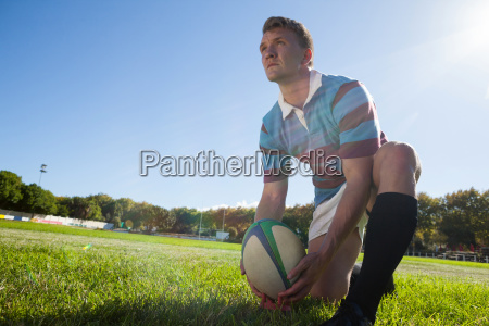 low angle view of rugby player