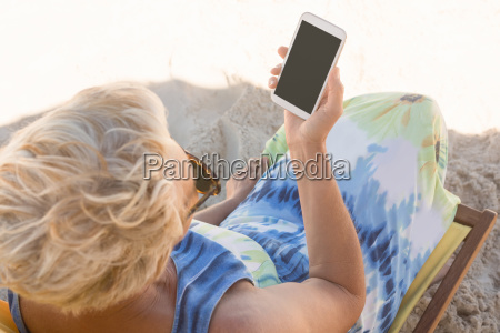 senior woman using smart phone while
