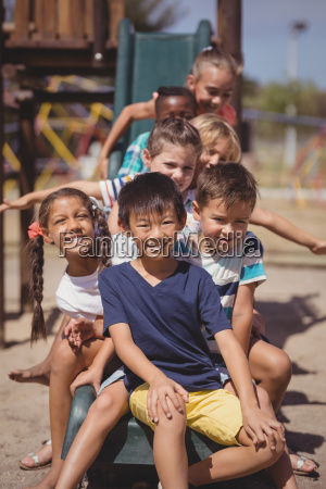 happy schoolkids playing in playground