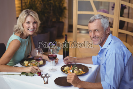 portrait of mature couple having dinner