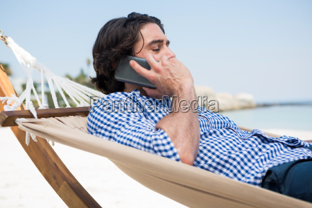 side view of man using smartphone