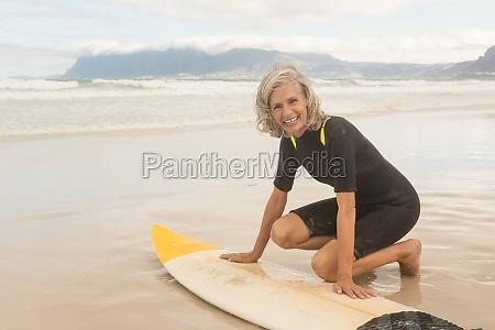portrait of smiling senior woman preparing