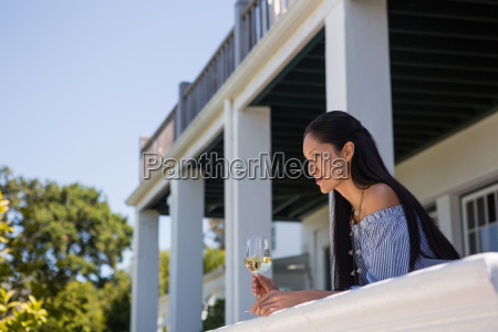 thoughtful young woman with white wine