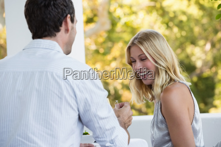 rear view of man proposing happy