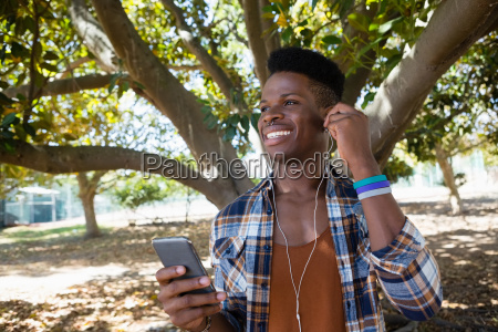 young man with earphones listening to