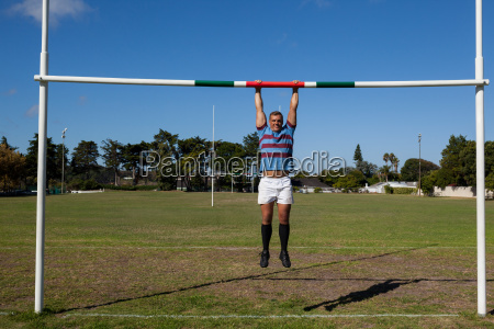 full length of rugby player hanging