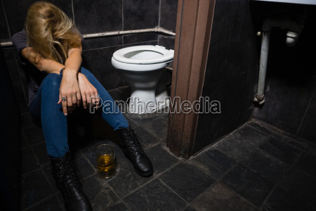 woman sleeping in the washroom