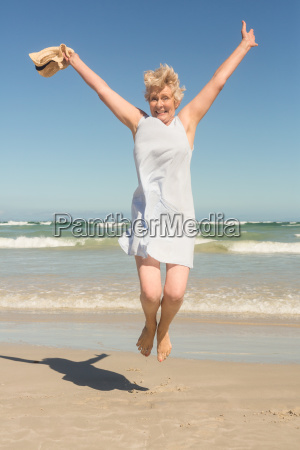 portrait of happy senior frau springt