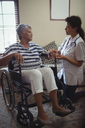 female doctor interacting with senior woman