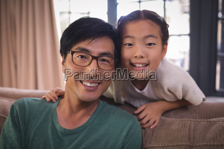 portrait of smiling father and daughter
