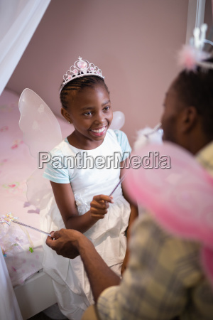 father and daughter wearing costume wings