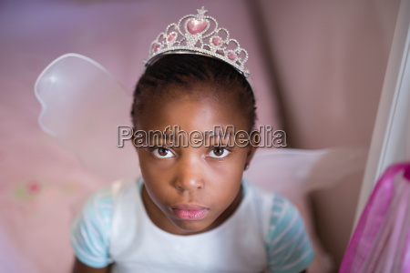 serious little girl wearing fairy costume