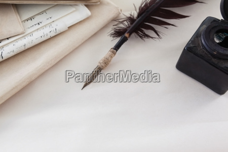 quill feather ink bottle and legal