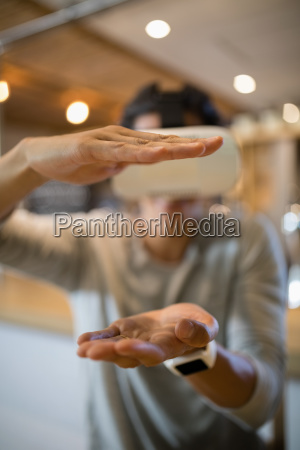 man using virtual reality headset in