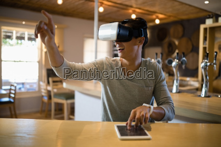 man using virtual reality headset and