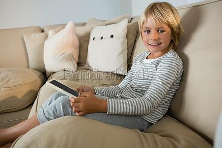boy using digital tablet in the