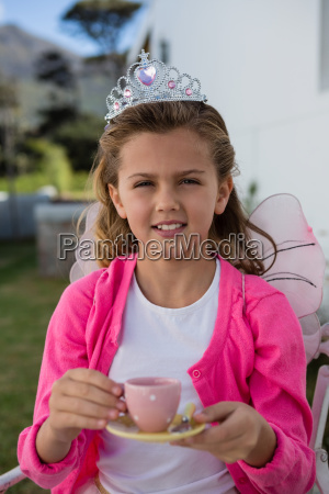 girl in fairy costume holding coffee
