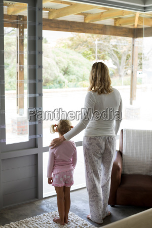 mother and daughter standing together at