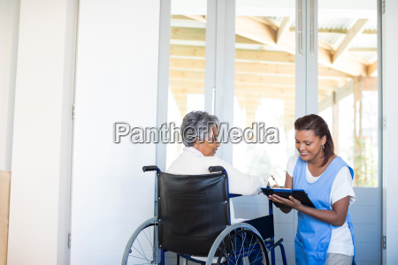 disability senior woman discussing with female
