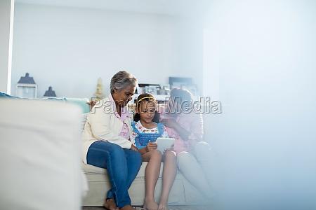 happy family using digital tablet in