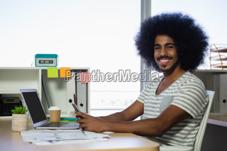 portrait of man using phone in
