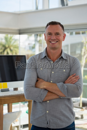 portrait of confident businessman standing at