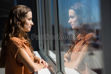 side view of thoughtful businesswoman looking