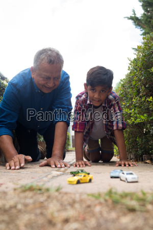 boy and grandfather playing with toy