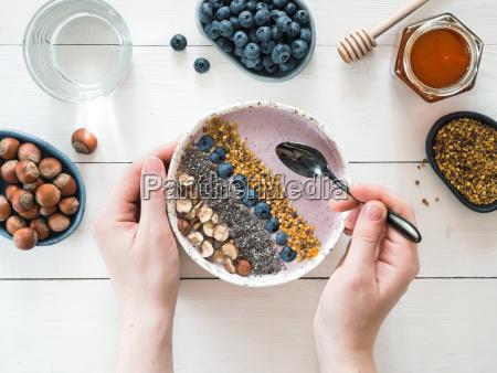 breakfast bowl in woman hands