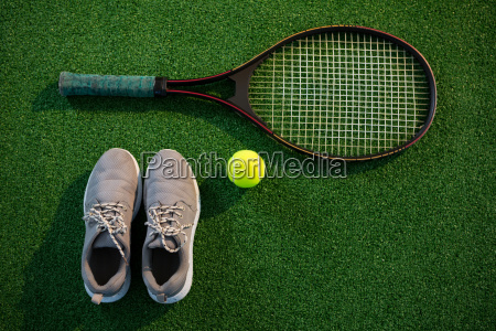 overhead view of racket with tennis