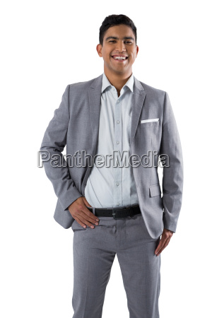 happy businessman standing on white background