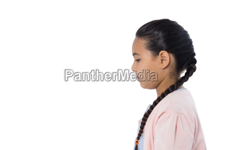 thoughtful girl standing against white background