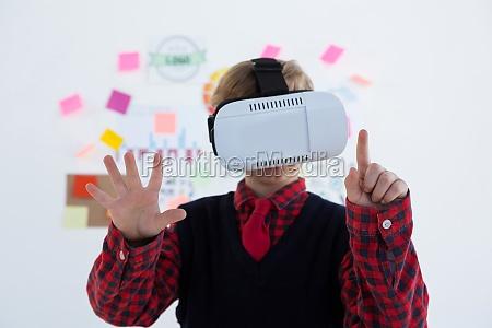 boy as business executive using virtual