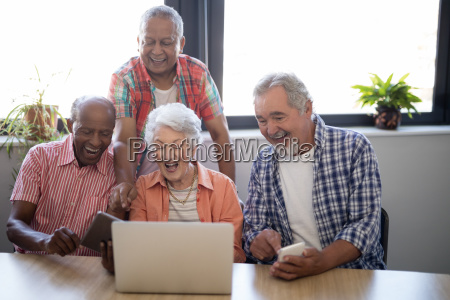 happy senior people using technology at