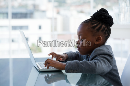 side view of businesswoman using laptop