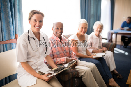 portrait of smiling female doctor sitting