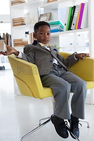 full length portrait of businessman sitting
