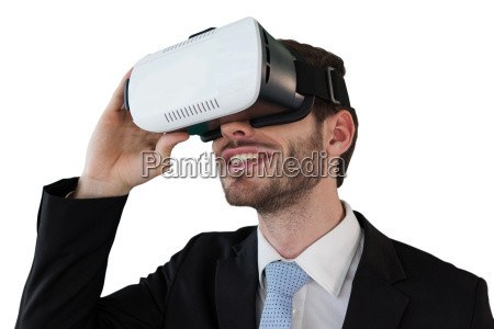 smiling businessman holding vr glasses