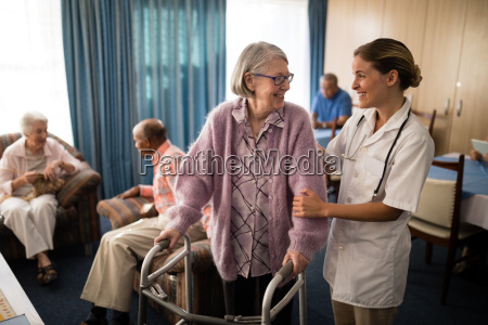 smiling female doctor looking at senior