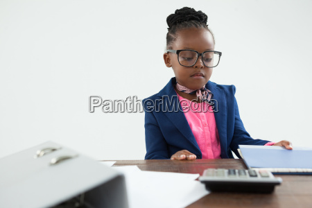serious businesswoman looking at files in