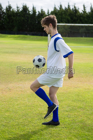 side view of soccer player playing