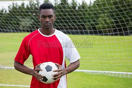 portrait of serious confident male soccer