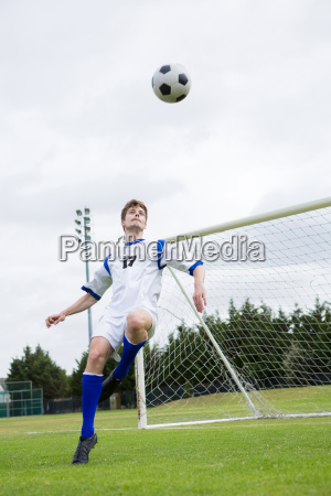 full length of soccer player playing
