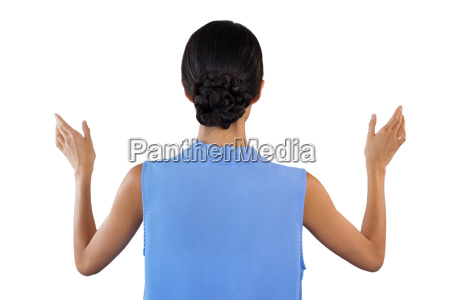 rear view of businesswoman gesturing while