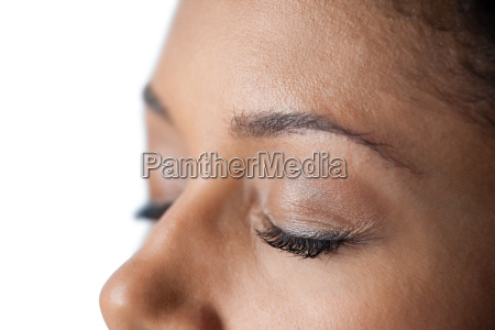 closed womans eye and nose against